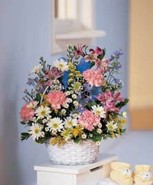 Pastel flowers in a basket