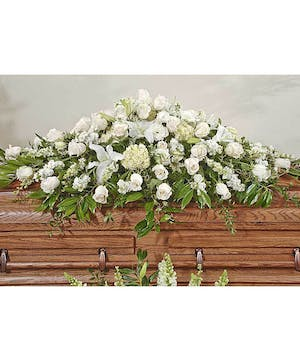 All white traditional spray for the casket.