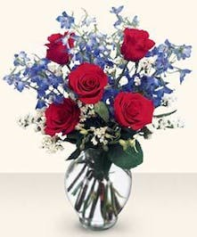 Red roses and delphinium.