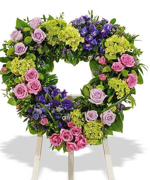 A unique and sentimental wreath displayed on an easel.