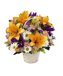 Natural and beautiful flowers in a handled basket