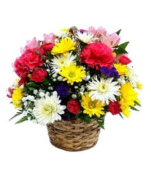 A sweet basket of blooms spreads joy to all.