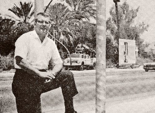 Elmer Schienbein rests his foot on the curb outside Phoenix Flower Shop, soon after becoming owner